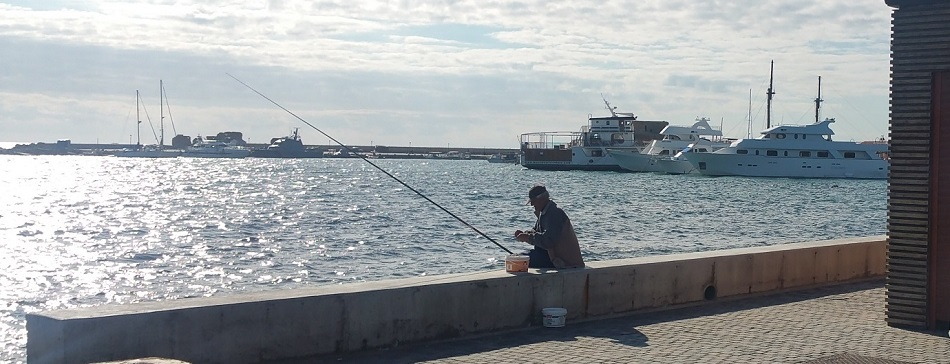 Sunny weather at Paphos Cyprus. Fishing at Paphos harbour