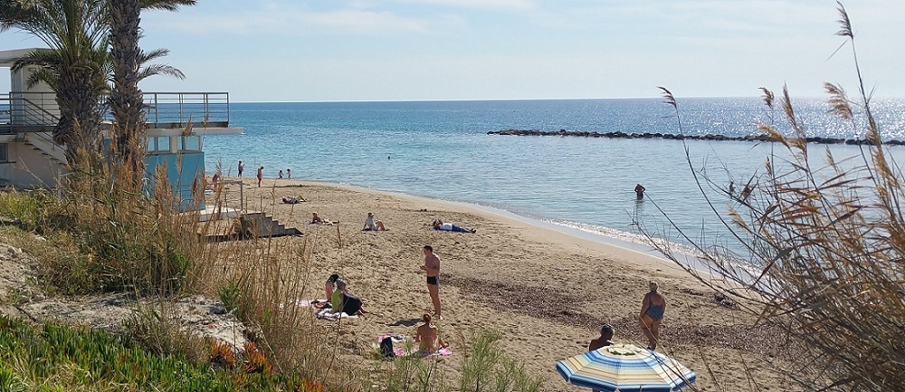 Cyprus beaches in March - Sunbathing near Aloe hotel at SODAP Beach, Paphos