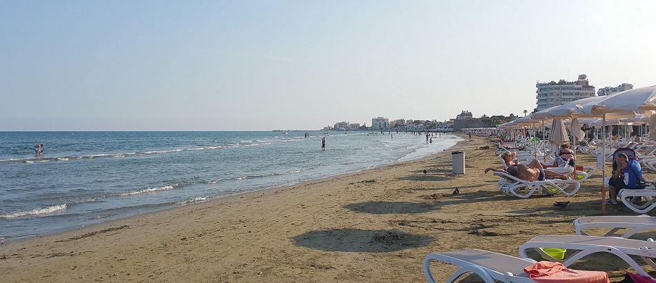 Fine weather at Finikoudes beach with visitors swimming and sunbathing